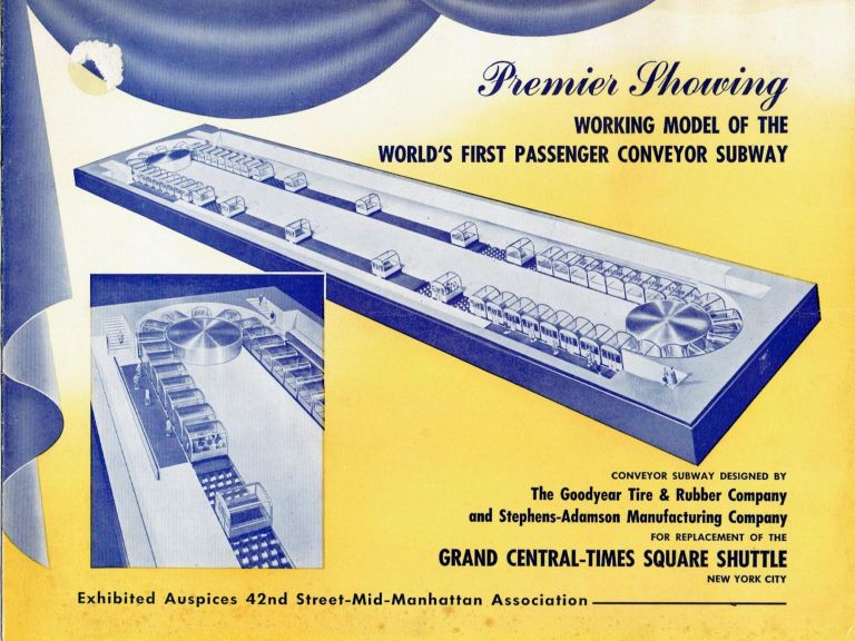 Premier Showing Working Model Of The World's First Passenger Conveyor Subway. Transportation, Goodyear Tire, Rubber Company.